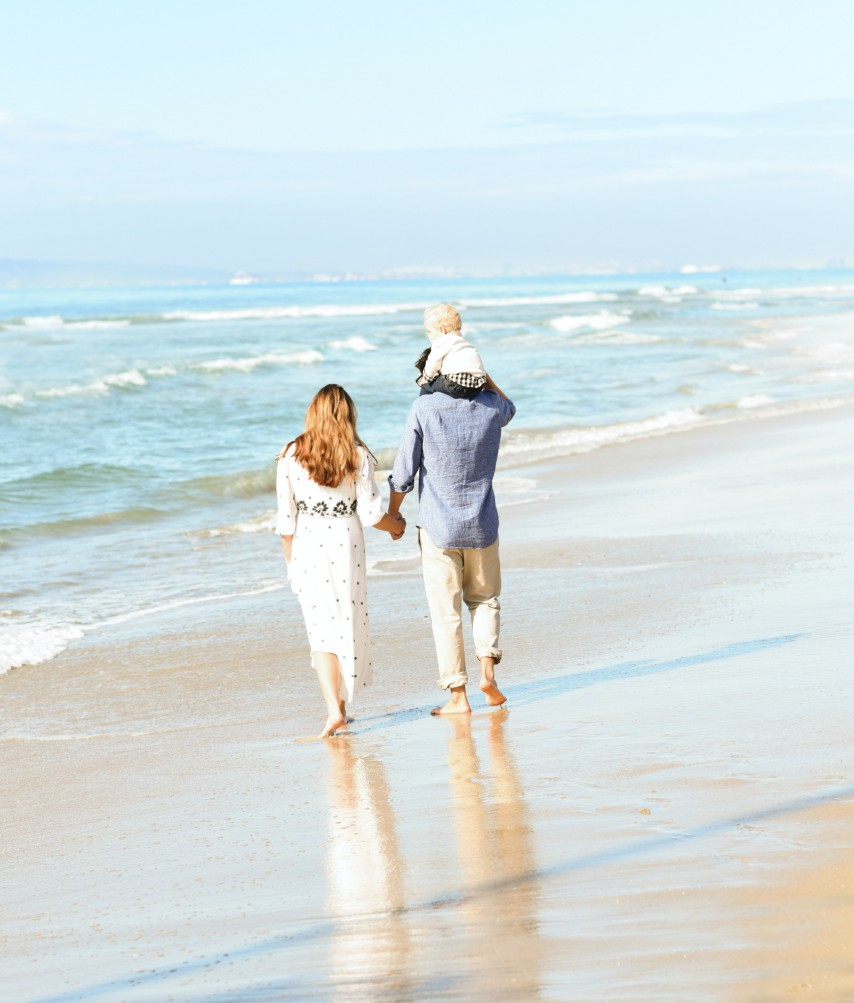 Family Walking on Beach | Suzanne Polino REALTOR